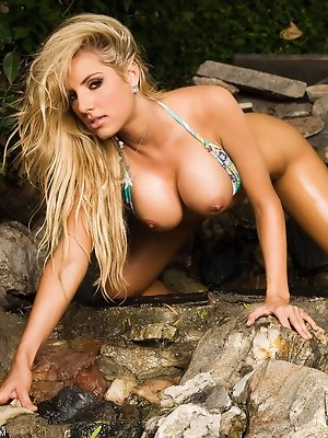 Teagan Presley is a true daredevil at heart - shooting her latest bikini/nude photo shoot right at the edge of a steep tropical rock cliff precipice!